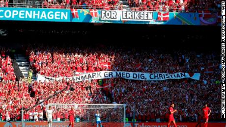 A banner of support was raised as those inside the stadium paid tribute.
