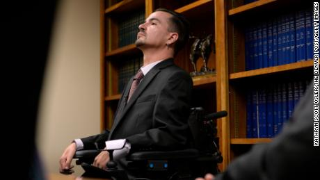 Brandon Coats listens as his attorney talks about their case at the attorney's office in Centennial, Colorado, in 2015. Coats, his family, and his attorney, Michael Evans, say they are disappointed in the Colorado Supreme Court ruling that Monday affirmed lower courts' rulings that businesses can fire employees for the use of marijuana even if it's for medical use and even if it's done off-duty. Coats, who is a quadriplegic, was fired from his job at Dish Network in 2010 for testing positive for marijuana in a random company drug test.