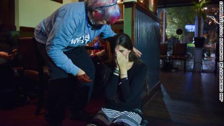 Roem falls to her knees after getting a call from Joe Biden congratulating her for her 2017 victory at an election watch party in Gainesville, Virginia.