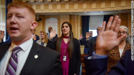 Roem and other delegates are sworn in on the floor of the House of Delegates on Roem's first day in office at the Virginia State Capitol.