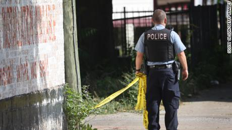 Police secure the scene of a shooting on June 15, 2021, in the Englewood neighborhood of Chicago. Five people were killed at a home during an early-morning shooting and several others were hospitalized.