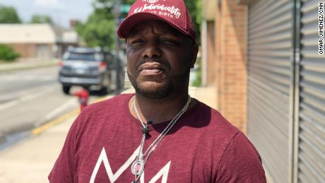 Jervon Hicks stands outside CRED's office in his South Side Chicago neighborhood of Roseland.