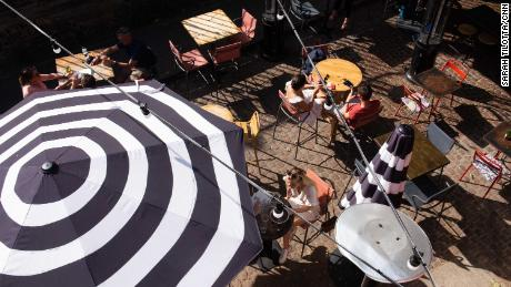 Diners on a terrace near London's Borough Market last month. Brits have been allowed to go for a meal outdoors or indoors with up to six people or as two households since mid-May.