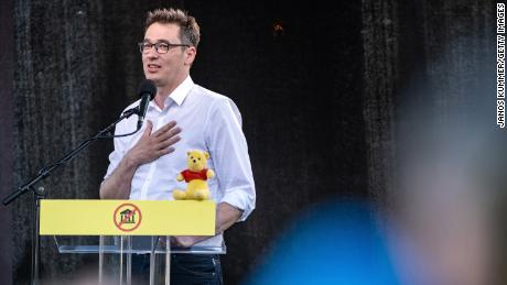 Budapest Mayor Gergely Karacsony, adresses protesters. The Winnie the Pooh toy is a reference to Chinese leader Xi Jinping, who critics say bears a resemblance to the character.