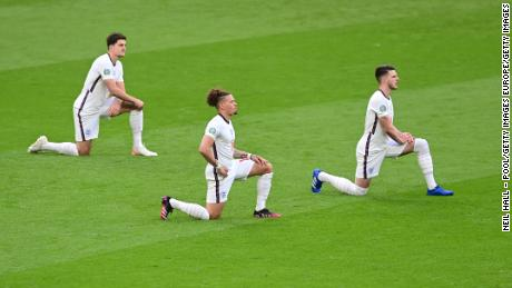 England's Harry Maguire, Kalvin Phillips and Declan Rice take a knee ahead of Tuesday's match.