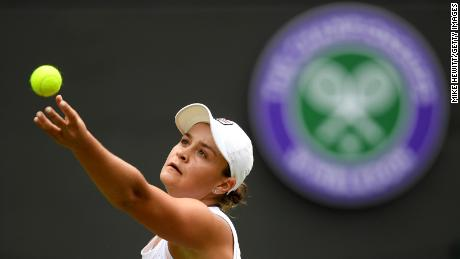 Barty serves in her ladies' singles first round match against Saisai Zheng during Wimbledon in 2019.