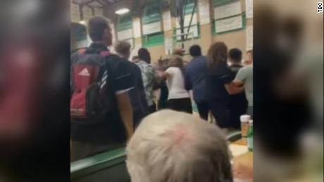 A high school basketball coach was fired after tortilla-throwing incident involving rival team