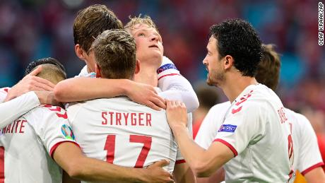Denmark's Dolberg celebrates with teammates after scoring his side's second goal against Wales.