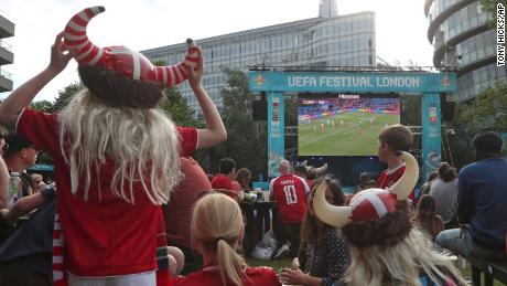 Danish supporters react at a fan area in Potters Field in London.