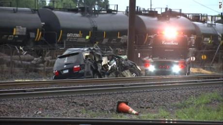 Three people are dead and three children injured after a vehicle was struck by a train