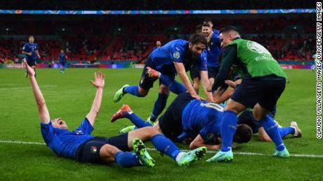 Pessina and his teammates celebrate scoring his team's second goal against Austria.