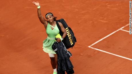 Williams waves goodbye to the crowd after her straight sets defeat  to Elena Rybakina at the 2021 French Open.