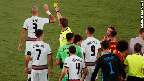 Pepe receives a yellow card for a challenge on Belgium's Hazard.