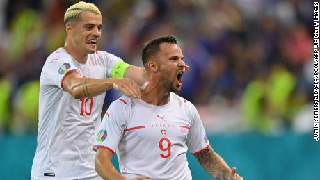 Haris Seferovic celebrates after giving Switzerland the lead.