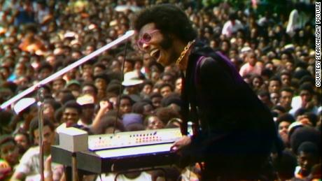 Sly Stone performs at the Harlem Cultural Festival in 1969, featured in the documentary 'Summer of Soul' (Courtesy of Searchlight Pictures).