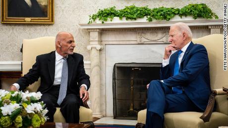 US President Joe Biden hosts Afghanistan President Ashraf Ghani in the Oval Office at the White House June 25, 2021.