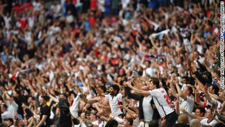 England supporters celebrate their win in the UEFA EURO 2020 round of 16 football match between England and Germany at Wembley Stadium.