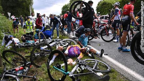 Italy's Kristian Sbaragli (left) and France's Bryan Coquard (right) lie on the ground after crashing during the first stage of the Tour de France.