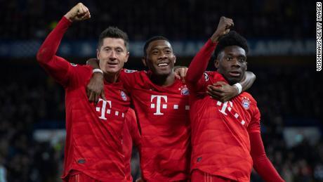 Davies (right) with Bayern star Robert Lewandowski (left) and former Bayern defender David Alaba (center).