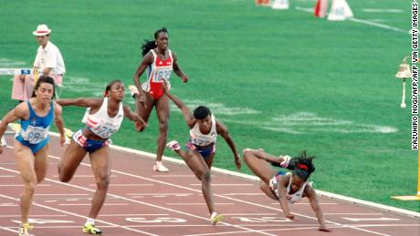 Devers (right) dives across the finish line of the 100m hurdles final at the 1992 Olympics having hit the last hurdle.