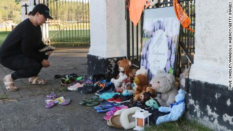 Lucy Sager, visits a growing memorial near the site of the former residential school.