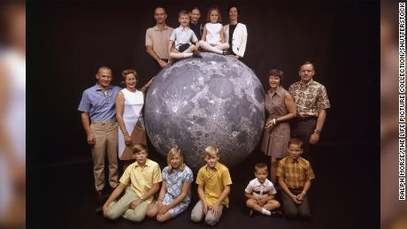 A group portrait of the Apollo 11 astronauts and their families. At the top, from left: astronaut Michael Collins, his children Mike, Kate and Ann, and his wife, Pat; at left, astronaut Buzz Aldrin, his wife, Joan, and children Mike, Jan, and Andy; at right, astronaut Neil Armstrong with his wife, Janet, and children Rick and Mark.