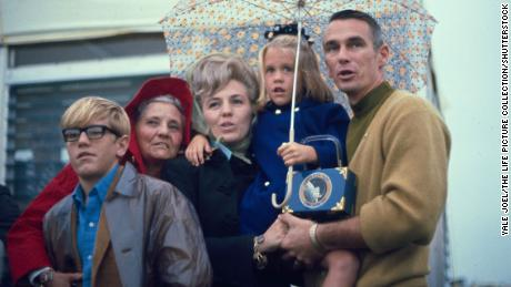 Six-year-old Amy Bean is held in the arms of close family friend and astronaut Gene Cernan (far right), as Amy's father, Alan, launches to space on Apollo 12 from Cape Kennedy, Florida, in November 1969.