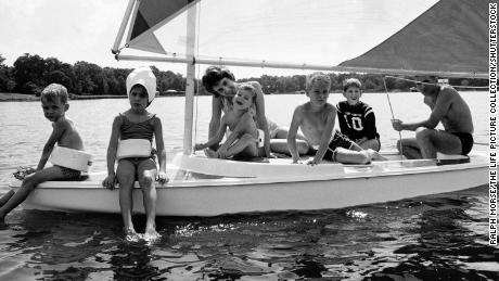 Gayle Anders on a sailboat with her parents and brothers in Texas, 1968.
