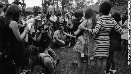 Barbara Lovell and her mother, Marilyn, and siblings, Jeffrey and Susan, face the mass gathering of press in their front lawn following the successful return of the Apollo 13 crew, April 1970.
