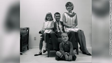 Sheryl Chaffee (left) poses with her father, Roger, her mother, Martha, and her brother, Stephen, for a portrait in their home in 1965, two years before the Apollo 1 fire.