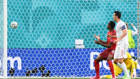 Denis Zakaria watches as his deflection puts Spain ahead in the match.