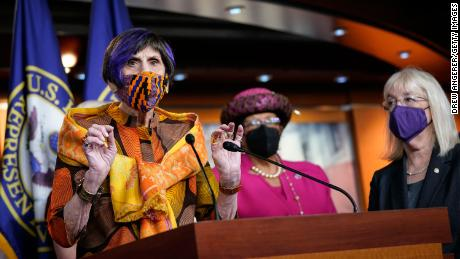 DeLauro, left, speaks during a news conference about the Paycheck Fairness Act while Murray, right, looks on.
