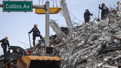 Rescuers search for victims at a collapsed South Florida condo building Monday.