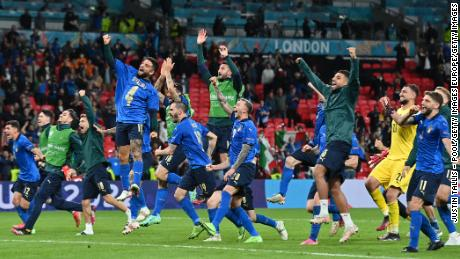 Players of Italy celebrate with their fans following the team's victory against Spain.