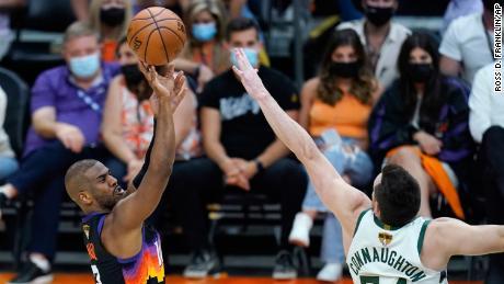 Paul shoots a 3-pointer over Bucks guard Pat Connaughton.