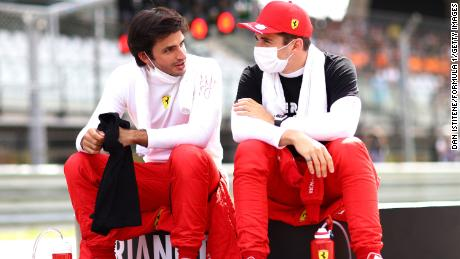 Carlos Sainz and Leclerc  talk on the grid ahead of the Styrian Grand Prix at Red Bull Ring on June 27, 2021 in Spielberg, Austria.