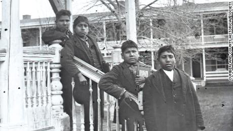 Four male students posed on the grounds of the Carlisle Indian Industrial School in 1879. The remains of Dennis Strikes First (Blue Tomahawk), second from left, will be repatriated to the Rosebud Sioux reservation next week.