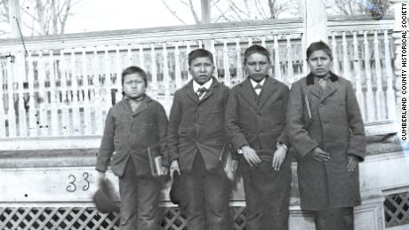 Four boys posing for a photo on the grounds of the Carlisle Indian Industrial School in 1879. Alvan Kills Seven Horses (One That Kills Seven Horses), second from left, was buried there and his remains are among those that will be repatriated to the Rosebud Sioux reservation next week.