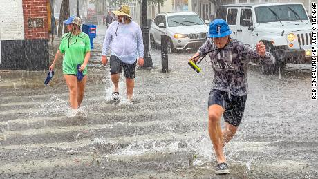 Pedestrians dash across a street in Key West, Florida, on Tuesday.
