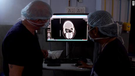 Surgeons examine an X-ray for signs of infection in Srinivas' brain.
