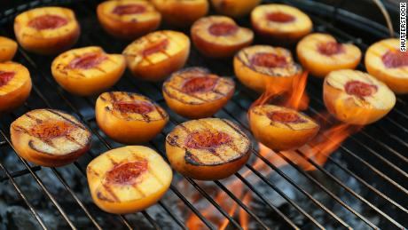 Grill peaches to bring out a sweet and smoky flavor.