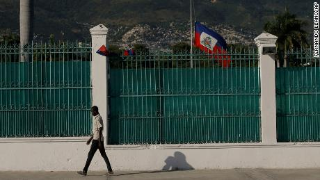 The Haitian flag flies at half-mast at the Presidential Palace in Port-au-Prince, Haiti, on July 10, three days after President Jovenel Moise was assassinated in his home.