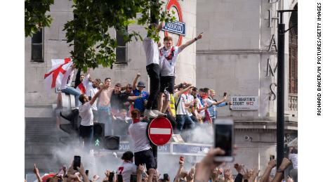 Hours before the England plays Italy in Euro 2020 final, thousands of supporters crowd outside Leicester Square tube station.