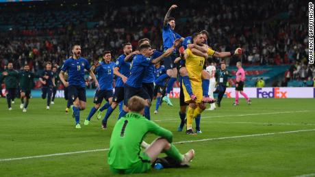 Italian players celebrate after the penalty shootout against England.