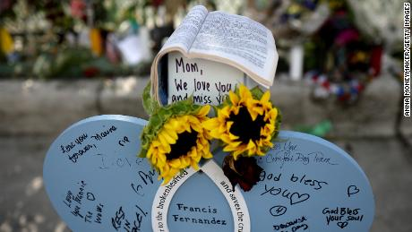 Notes are written on a makeshift headstone for Francis Fernandez, a victim in the collapse.