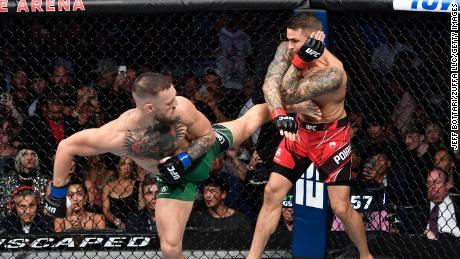 McGregor kicks Poirier during the UFC 264 event at T-Mobile Arena in Las Vegas, Nevada.