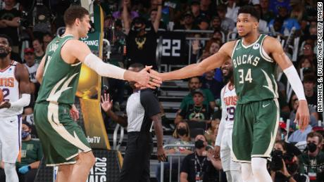 Brook Lopez high-fives Antetokounmpo during Game 3 of the NBA Finals.