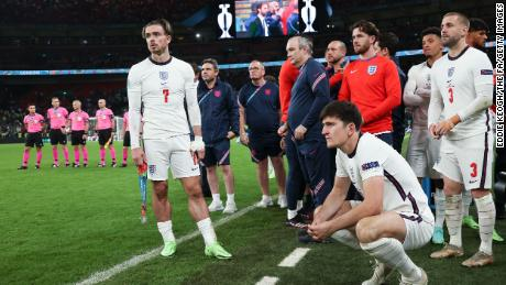 Jack Grealish and Harry Maguire look disconsolate following England's defeat.