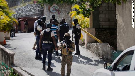Security forces conduct an investigation as a soldier stands guard at the entrance to the residence of Haitian President Jovenel Moise, in Port-au-Prince, Haiti, Wednesday, July 7, 2021.