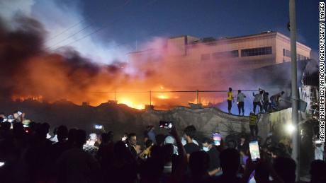 DHI QAR, IRAQ - JULY 13: Smoke rises after fire broke out for an unknown reason in a COVID-19 isolation ward of Al-Hussein Hospital in Nasiriya city in Dhi Qar governorate, Iraq on July 13, 2021. At least 36 people have been killed and five others injured. (Photo by Arshad Mohammed/Anadolu Agency via Getty Images)